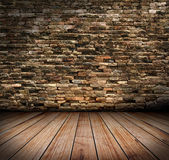 Old room with brick wall and wooden floors — Stock Photo