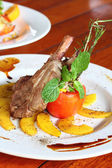Rack of lamb with grilled peach — Stock Photo