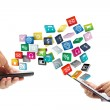 Hands holding the phone and tablet  pc with colorful application icons — Stock Photo #43271325