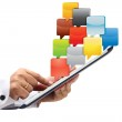 Hand pointing at Tablet PC with cloud of application icons — Stock Photo