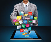 Business man use tablet pc with cloud of colorful application — Stock Photo