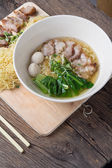 Noodles bowl on wooden background — Stock Photo
