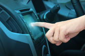 Pushing on a touch screen interface navigation system — Stock Photo