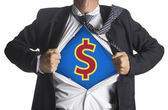 Businessman showing a superhero suit underneath dollar symbol — Stock Photo