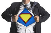 Businessman showing a superhero suit underneath his suit — Stock Photo