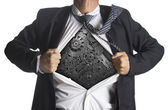 Businessman showing a superhero suit underneath machinery metal gears idea concept — Stockfoto