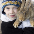 Boy holds on the shoulder of rabbit. — Stock Photo