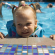 Little girl in pool. — Stock Photo