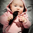 Stock Photo: Baby with microphone
