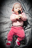 Baby with microphone — Stock Photo