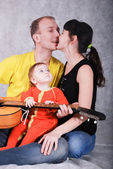 Happy young parents and little baby with guitar — Stock Photo