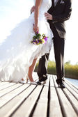 Newlyweds outdoors — Stock Photo