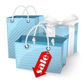 Vente. sacs à provisions et boîte avec rubans sur fond blanc. — Vecteur