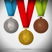 Gold, silver and bronze medals with ribbon. — Stock vektor