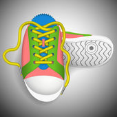 Colorful sneakers on a grey background. — Vector de stock