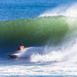 Stock Photo: Surfing Riding Hollow Wave