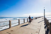 Surfer Walks Pier Ocean Jump — Stock Photo