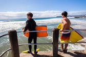 Surfing Body-Boarders Pier Jump — ストック写真