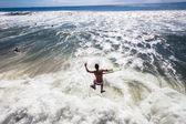 Surfing Body-Boarder Pier Jump — Zdjęcie stockowe