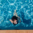 Girl Swims Surfacing Underwater Pool — Stock Photo