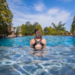 Girl Sitting Swimming Pool Waters — Stock Photo