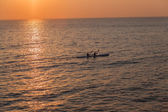Surf-Ski Paddlers Ocean Reflections Sunrise — Stock Photo