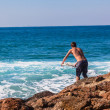 Stock Photo: Surfing Rider Rock Jump Entry