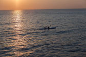 Dawn Sun Rising Ocean Surf-Ski Paddlers — Stock Photo