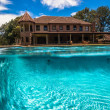 Stock Photo: Swimming Pool Waterline Split Home Summer