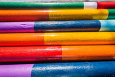 Wood Poles Painted Colors — Stock Photo