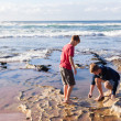 Boys Exploring Reefs Beach — Stock Photo