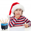 Stock Photo: Little boy writing a letter to Santa