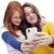 Teen girls with phone — Stock Photo