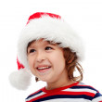 Little boy with santa hat on head — Stock Photo