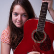 Young girl with guitar portrait — Stock Photo