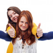 Teens with thumbs up sign — Stock Photo
