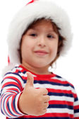 Little boy giving you thumbs up — Stock Photo