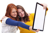 Teen girls with tablet — Stock Photo