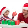 Father and son with gift boxes — Stockfoto