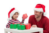 Father and son with gift boxes — Stock Photo