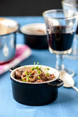 Boeuf bourguignon classic french beef stew on blue table with a — Stock Photo