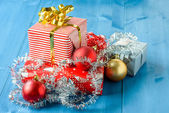 Christmas gifts with some ornaments on a blue background — Stock Photo