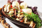Stuffed eggplant and potatoes with mushrooms — Stock Photo