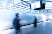 Speed Train passed through station with people wating — Stock Photo