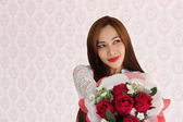 Woman happy in love rose 1 — Stock Photo