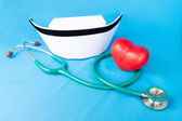 Stethoscope and nurse hat — Stock Photo