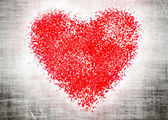 Red heart on grey grangy background — Stock Photo