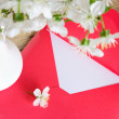 Red envelope and white vase of cherry blossom on wooden backgrou — Stock Photo #45209663