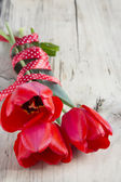 Tulips bouquet on wooden background.Space for text. — Stock Photo
