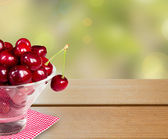 Bowl of cherries with empty space.Backgrounds. — Stock Photo